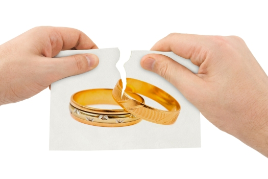 Hands tear picture with wedding rings isolated on white background